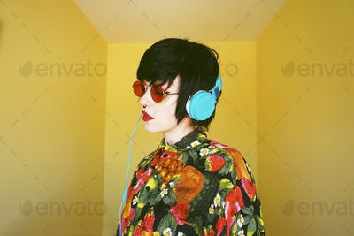 Cool androgynous dj woman in vibrant colors