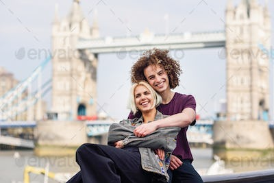 Happy couple hugging at the Tower Bridge