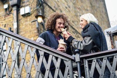 Happy couple eating Doner kebab, shawarma, in Camden Town
