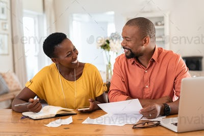 Mature couple managing home finance