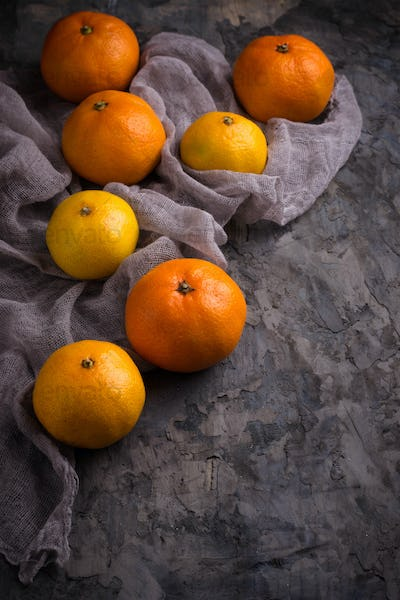Sweet orange tangerines on concrete background