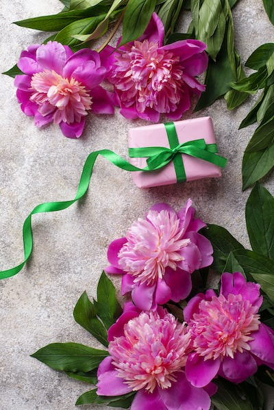 Pink peony flowers and gift box