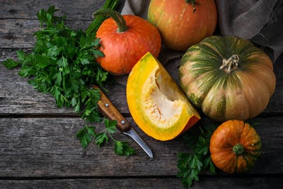 Autumn still life with pumpkins on wooden background