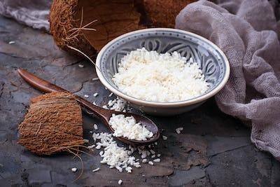 Fresh coconut flakes on grey background