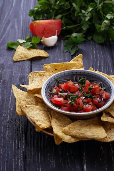 Mexican corn chips nachos with salsa dip