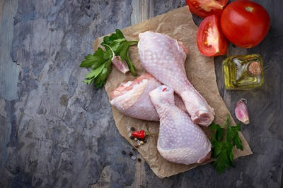 Raw chicken legs with parsley