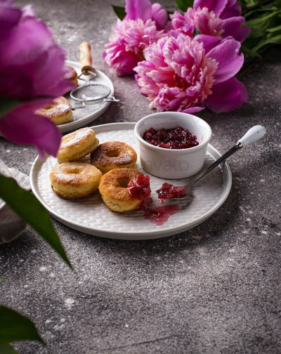Homemade donuts with rose jam