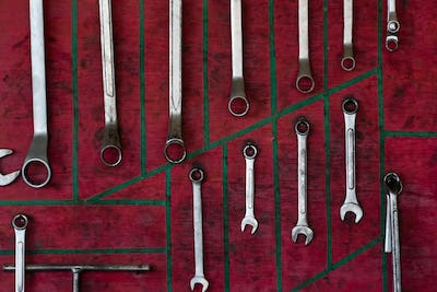 Tools on red wall