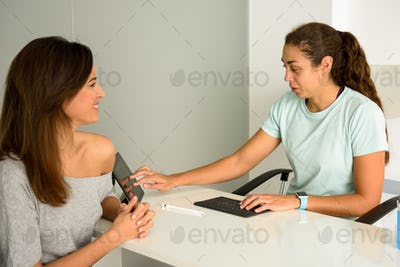 Female physiotherapist explaining diagnosis to her woman patient.