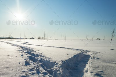 snowy landscape with footpathes