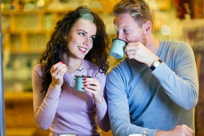 Romantic couple having date in coffee shop