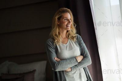 Portrait of beautiful woman standing in room