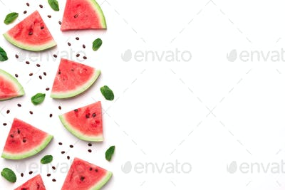 Fresh watermelon slices with seeds and leaves on white background