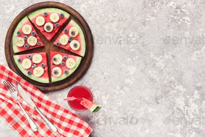 Fresh watermelon pizza and smoothie on grey background