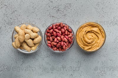 Bowls with peanuts and peanut butter
