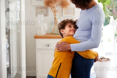 Loving Son Giving Mother Hug Indoors At Home