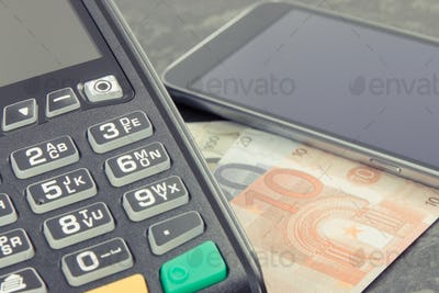 Payment terminal, money and smartphone with NFC technology using for cashless paying