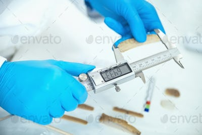Archaeologist Measuring Lithics with Caliper in Laboratory