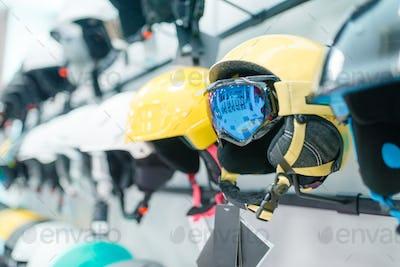Rows of ski and snowboarding helmets closeup
