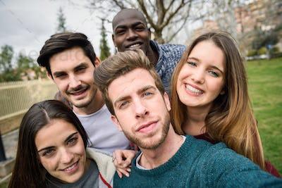 Multiracial group of friends taking selfie