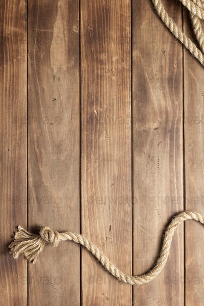 ship rope at wooden board background