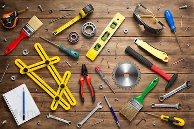 set of tools and instruments at wooden table