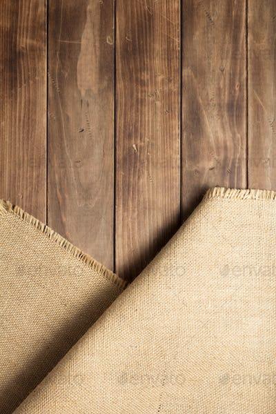 burlap hessian sacking on wooden background table