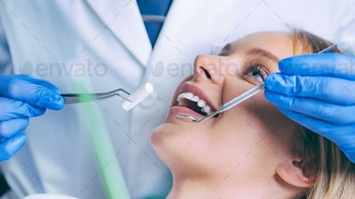 Dentist Working with Young Female Patient
