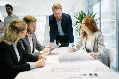 Group of business people collaborating in business office