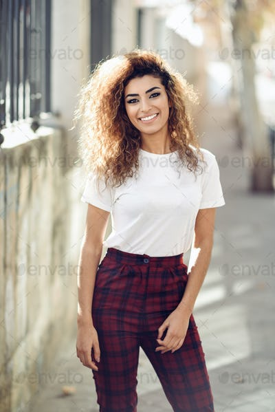 Arab girl in casual clothes in the street.