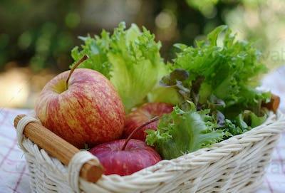 Apple and vegetable in wicker basket