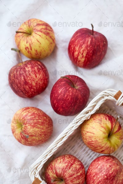 Red apple in wicker basket