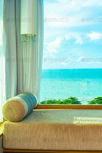 Beautiful comfortable pillow on sofa with sea ocean white cloud