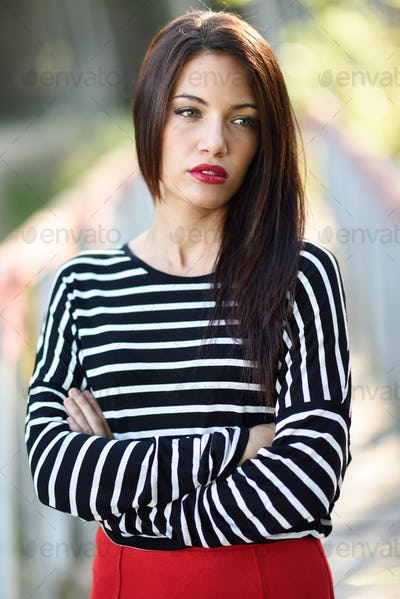 Young woman with green eyes wearing young clothing