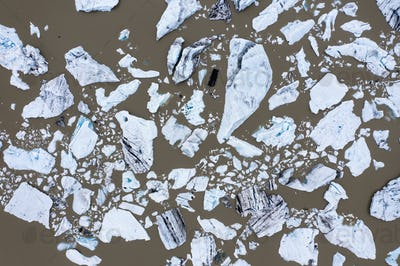 Aerial view of floating icebergs in Fjallsarlon glacier lake, Iceland