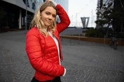 Portrait Of Beautiful Young Blonde Woman With Her Hand in the Hair In City