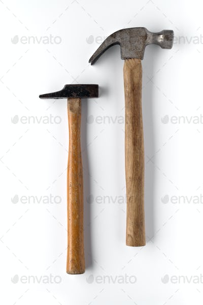two used hammers isolated and shaded on white background