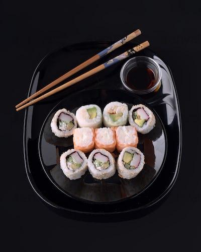 sushi on black base in shiny black porcelain