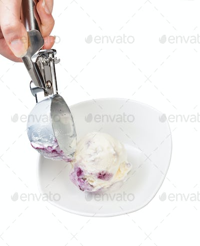 putting blueberry ice cream in bowl by scoop