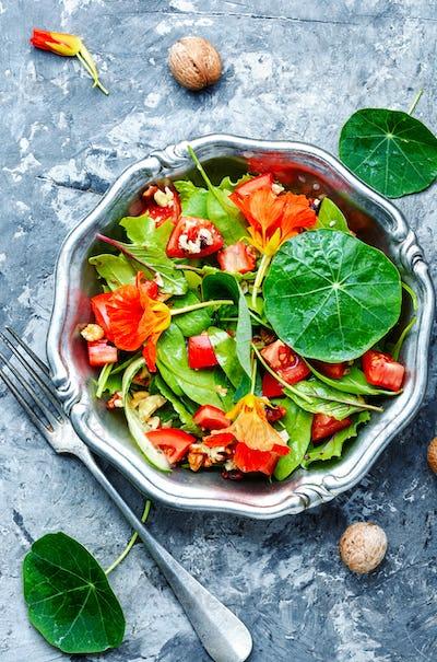 Salad with vegetables, nuts and nasturtium