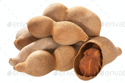 Tamarind pods, pile of, isolated