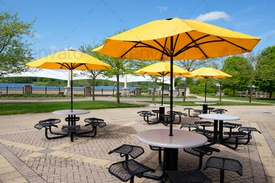 Outdoor seat with table and parasol