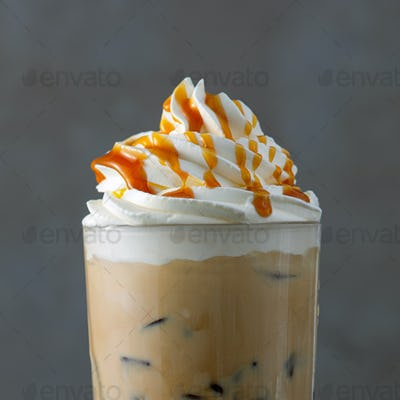 iced coffee latte with whipped cream and caramel sauce