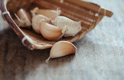 Close-up view of garlic clove in bamboo basket