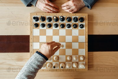 Male chess players, move of white, top view