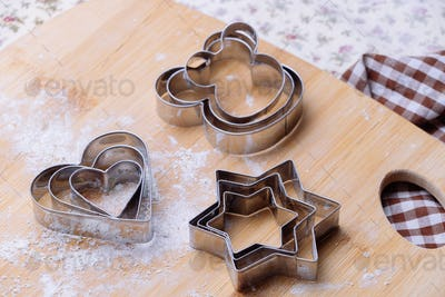 Pastry cutter on wooden board