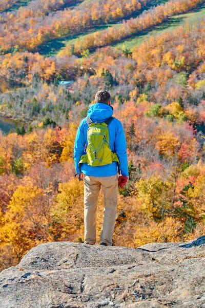 Backpacker man at Artist's Bluff in autumn