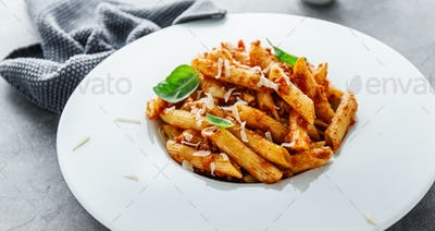 Bolognese penne pasta served on plate