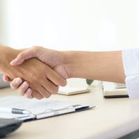 Business people shaking hands, partnership merger and acquisition concept