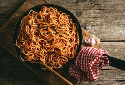 Italian spaghetti with tomato sauce in pan